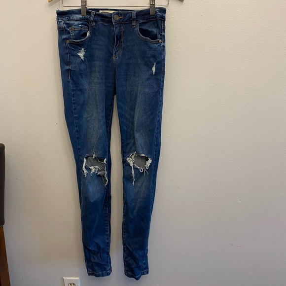 Blue ripped-knee skinny jeans